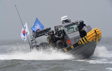 Members of  South Korea army, maritime policemen and the United Nations Command take part in a joint operation to keep Chinese fishing vessels from operating illegally off the west coast