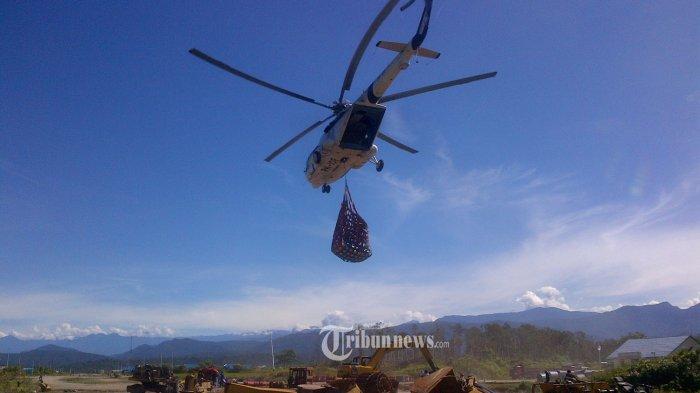 Mi-17 394-prajurit-tni-ad-bangun-jalan-di-provinsi-papua_20160614 1