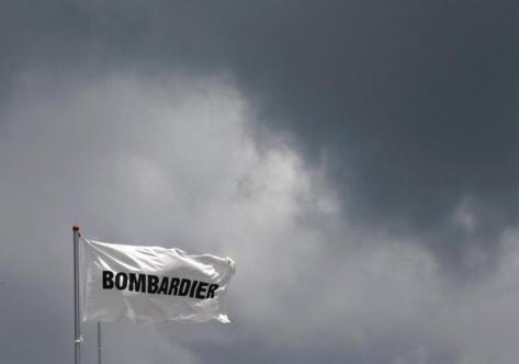 A Bombardier flag flutters amidst storm clouds at the Singapore Airshow at Changi Exhibition Center