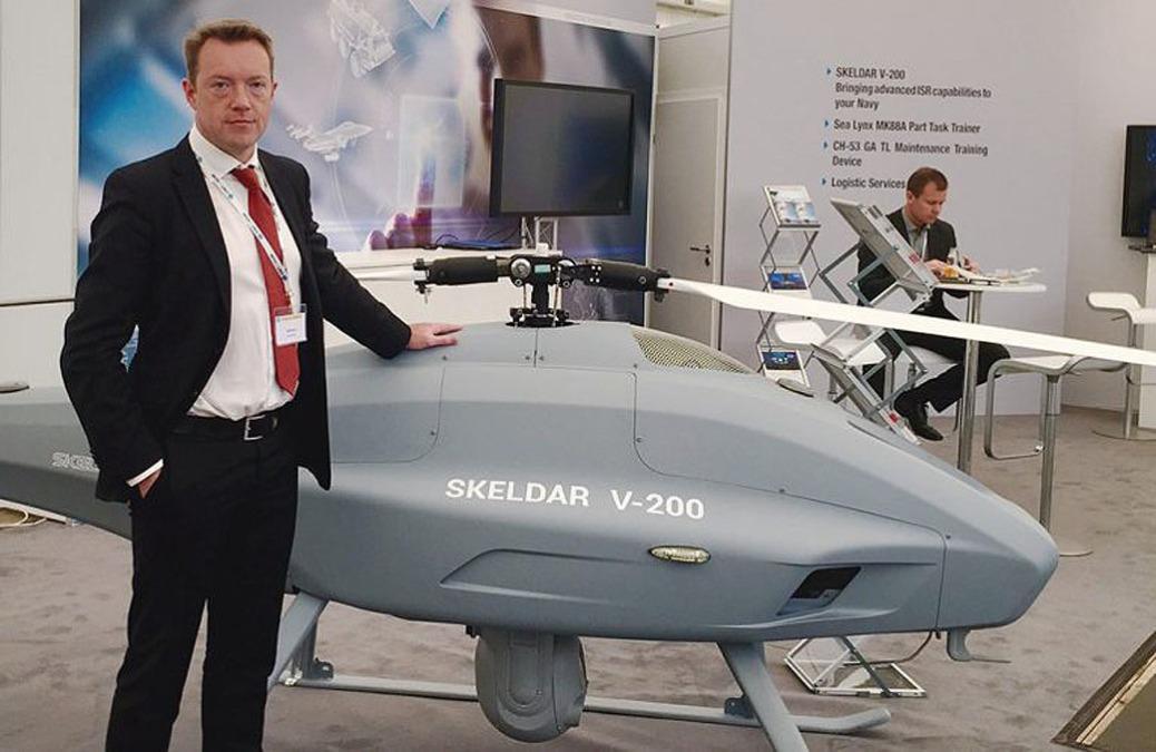 david-willems-ums-skeldar-global-business-development-director-stands-next-to-the-skeldar-v-200-vtol-e