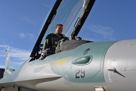 Lt. Col. Beau Strap Wilkins, 514th Flight Test Squadron, climbs into the cockpit of an Indonesian F-16C Fighting Falcon to conduct a functional check flight Nov. 21, 2017, at Hill Air Fo