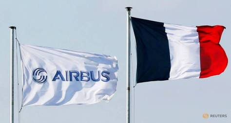 An airbus flag flies near a french flag at the entrance of airbus headquarters in colomiers near toulouse. (CNA)