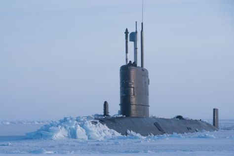 Royal Navy submarine HMS Trenchant breaking through the metre-thick ice of the Arctic Ocean on Ice Exercise 18. (Royal Navy)